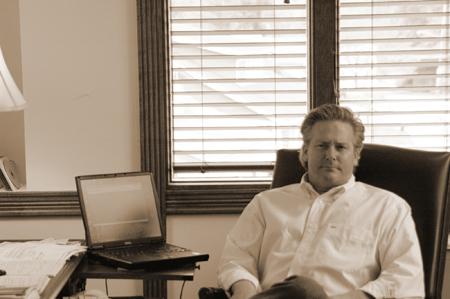 David Speaker at his desk